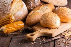 Fresh bread and wheat on the wooden royalty free stock photos