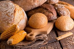 Fresh bread and wheat on the wooden royalty free stock photo