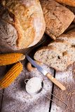 Fresh bread and wheat on the wooden royalty free stock photography