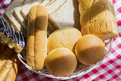 Different fresh breads on the table. Closeup of different fresh breads served above the dining table Royalty Free Stock Images