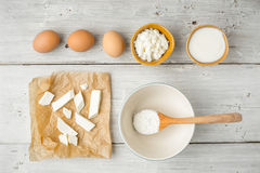 Different fresh cheese with yogurt and eggs on the white wooden table top view. Horizontal Royalty Free Stock Photos