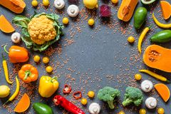 Different Fresh colorful organic vegetables. healthy raw vegan food on grey background with free copy space. Flat lay. Top view Stock Photo