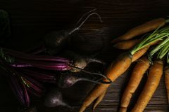 Different fresh farm vegetables, organic beetroots and carrots on rustic wooden background.  stock image