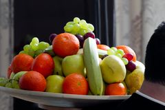 Different fresh fruit in the bowl on the table, ready to be eaten royalty free stock image