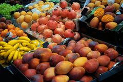 Different fresh fruits. In market place stock images