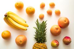 Different fresh fruits. Top view of Different sweet fresh fruits, isolated on white royalty free stock image