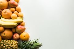 Different fresh fruits. Top view of Different fresh fruits, on white with copy space royalty free stock image