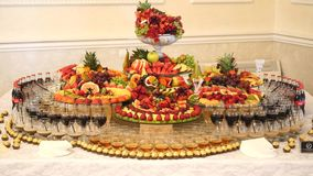 Different fresh fruits on wedding buffet table. Fruits and berries Wedding table decoration. Buffet reception fruit Stock Photos