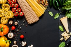 Different fresh ingredients for cooking italian pasta, spaghetti, fettuccine, fusilli and vegetables on a black Stock Images