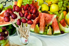 Different fresh and natural fruits on the table Stock Images