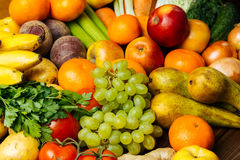 Different fresh raw vegetables and fruits background Stock Photos