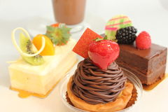 Different fruit  decorated pastries  cakes and slices of cakes. Royalty Free Stock Photography