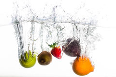 Different fruit drop in water Stock Photo