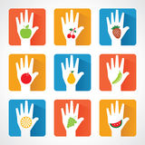 Different fruit icons and design with helping hand Royalty Free Stock Images