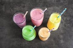 Different fruit milkshakes in glassware stock photography
