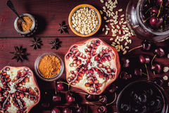 Different fruit and spices on the red wooden table. Concept of oriental fruits top view Stock Images