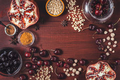 Different fruit and spices on the red wooden table. Concept of oriental fruits top view Royalty Free Stock Photography