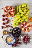 Different fruit and spices on the white wooden table. Concept of oriental fruits top view Royalty Free Stock Image