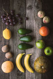 Different fruit on the wooden table top view Stock Photography