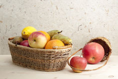Fruit in a basket. Different fruits in the basket and  on the table Royalty Free Stock Photography