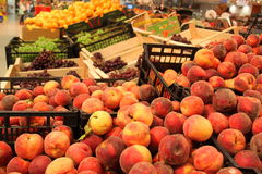 Supermarket stall with fresh peaches  Royalty Free Stock Photo