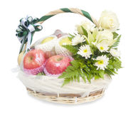 Different fruits and flowers in wicker basket. Isolated on white Royalty Free Stock Images