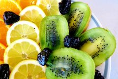 Different fruits, oranges, lemons, kiwi and prunes royalty free stock photo
