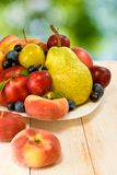 Different fruits on a plate Stock Images