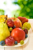 Different fruits on a plate Royalty Free Stock Images