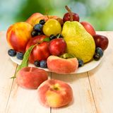 Different fruits on a plate Royalty Free Stock Photos