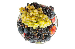 Different fruits in vase. Different fruits in a vase on a white background Royalty Free Stock Photos