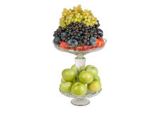 Different fruits in vase. Different fruits in a vase on a white background Stock Image