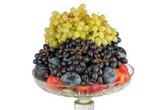 Different fruits in vase. Different fruits in a vase on a white background Royalty Free Stock Image