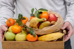 Different fruits in wooden tray Stock Photography