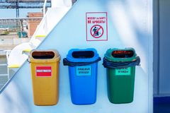Different garbage bins are for sorting garbage.  royalty free stock images