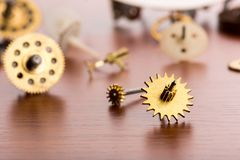 Different gears on the table closeup Royalty Free Stock Photography