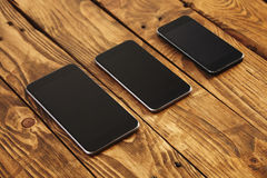 Different generations of modern smartphones isolated Stock Photos