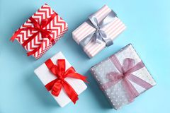 Different gift boxes on color background. Flat lay Stock Photos