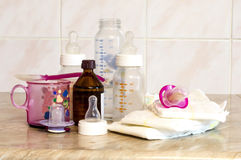 Different glass bottle with the mixture for feeding the baby Royalty Free Stock Image