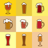 Different glasses of beer. With spume Royalty Free Stock Photography