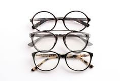 Different glasses with corrective lenses. On white background. Vision problem royalty free stock images