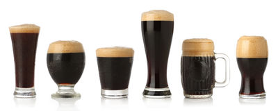 Different glasses of stout beer Stock Images