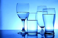 Different glasses of water Stock Photos