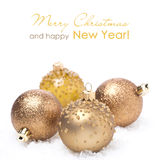 Different golden Christmas balls in the snow,  Stock Photography