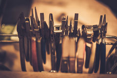 Different goldsmiths tools on the jewellery workplace.  Stock Images