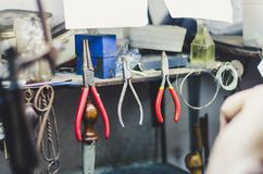 Different goldsmiths tools on the jewellery workplace. royalty free stock photography