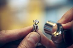 Different goldsmiths tools on the jewelry workplace. Jeweler at work in jewelry. Desktop for craft jewelry making with professional tools. Close up view of royalty free stock photo
