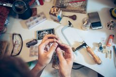 Different goldsmiths tools on the jewelry workplace. Jeweler at work in jewelry. stock photography