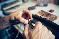 Different goldsmiths tools on the jewelry workplace. Jeweler at work in jewelry. stock image