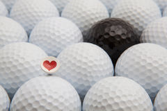 Different golf balls and romantic tee Stock Photography